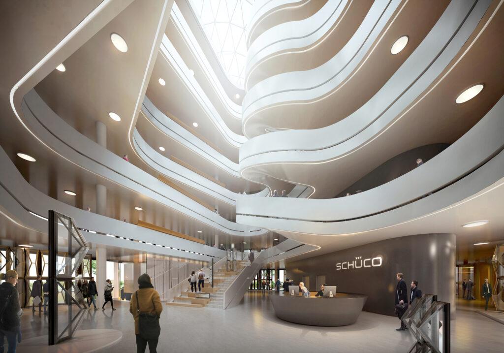 Das dynamische, über sämtliche Ebenen gestaltete Atrium ist architektonisches Highlight und zentraler Sammelpunkt des Gebäudes. Das Raumkonzept des Neubaus sieht eine offene kommunikationsfördernde Arbeitslandschaft vor, um den Dialog und Wissensaustausch der Mitarbeiter und Mitarbeiterinnen zu fördern.